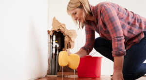 A lady cleaning water damage from her home